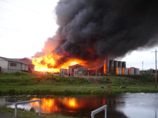 Fire rages through Hooper Bay, Alaska on Thursday, August 3, 2006
