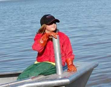 Alaskan 8-year old on open boat without PFD